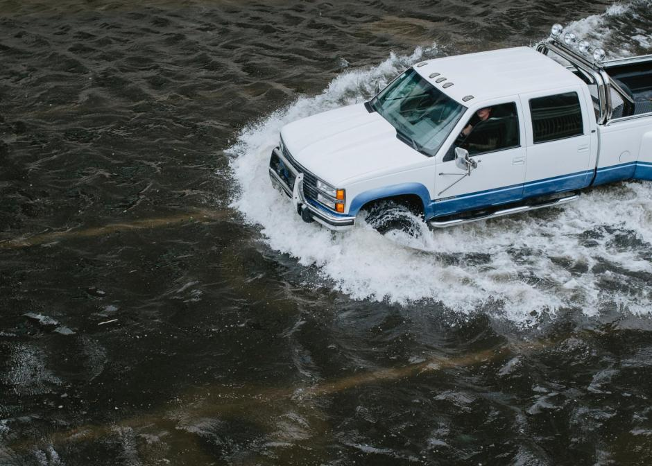 pickup truck driving through floodwater